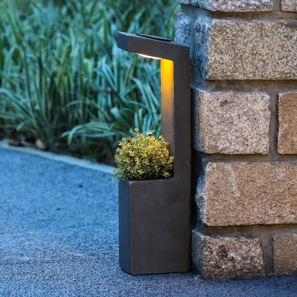 Stone Finish MgO 29in. H Planter with Solar Light. Opens flyout.