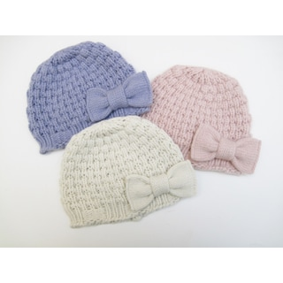 Cashmere baby hat in popcorn stitch with bow