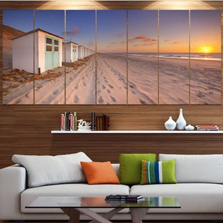 Designart 'Row of Beach Huts at Sunset' Modern Landscape Canvas Art