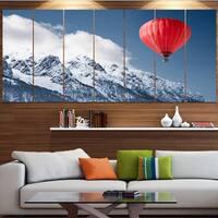 Designart 'Balloon Over Winter Hills' Landscape Wall Artwork - Multi-color