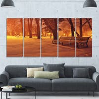 Designart 'Snow Covered Benches in Evening' Landscape Wall Artwork on Canvas - Multi-color