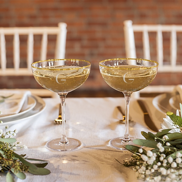 Personalized 8 oz. Gold Rim Coupe Flutes. Opens flyout.
