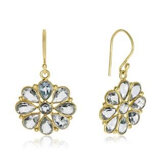 8 TGW Blue Topaz Flower Earrings In Yellow Gold Over Sterling Silver