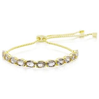 5 1/2 TGW White Topaz Adjustable Slide Tennis Bracelet In Yellow Gold Over Brass