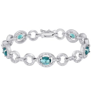 Dolce Giavonna Silver Overlay Simulated London Blue Topaz and Diamond Accent Oval Link Bracelet