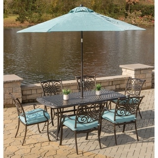 Hanover Traditions 7-Piece Dining Set in Blue with Cast-Top Dining Table, 9 Ft. Table Umbrella, and Umbrella Stand