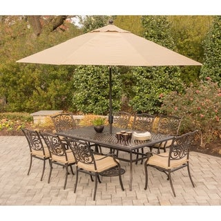 Hanover Traditions 9-Piece Dining Set in Tan with an 84 x 41 in. Cast-Top Dining Table, 11 Ft. Table Umbrella and Umbrella Stand