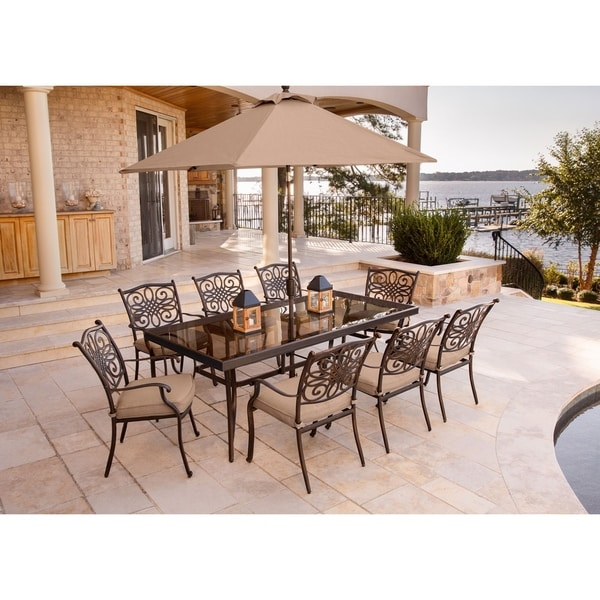 Hanover Traditions 9-Piece Dining Set in Tan with Extra-Long Glass-Top Dining Table, 11 Ft. Table Umbrella and Umbrella Stand