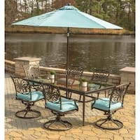 Hanover Traditions 7-Piece Dining Set in Blue with Extra Large Glass-Top Dining Table, 9 Ft. Table Umbrella, and Umbrella Stand