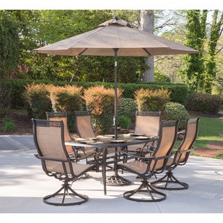 Hanover Manor 7-Piece Outdoor Dining Set with Six Swivel Rockers, a Cast-top Dining Table, a 9 Ft. Umbrella and Umbrella Stand