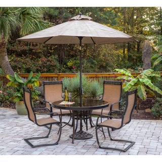 Hanover Monaco 5-Piece Outdoor Dining Set with C-Spring Chairs, Glass-top Dining Table, 9 Ft. Table Umbrella and Umbrella Stand