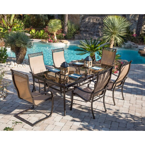 Hanover Monaco 7-Piece Dining Set with Four Stationary Dining Chairs, Two Spring Sling Chairs, and a Glass-top Dining Table