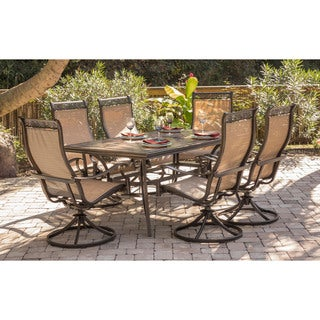 Hanover Monaco Tan Aluminum 7-piece Dining Set with Six Swivel Rockers and a 68 x 40-inch Dining Table