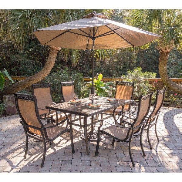 Hanover Monaco Tan Aluminum 7 Piece Dining Set With 9 Foot Table Umbrella  And