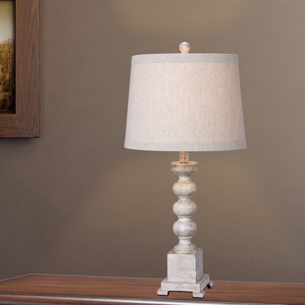 Fangio Lighting's ANT WHT 29 in. Resin Table Lamp in an Antique White Finish