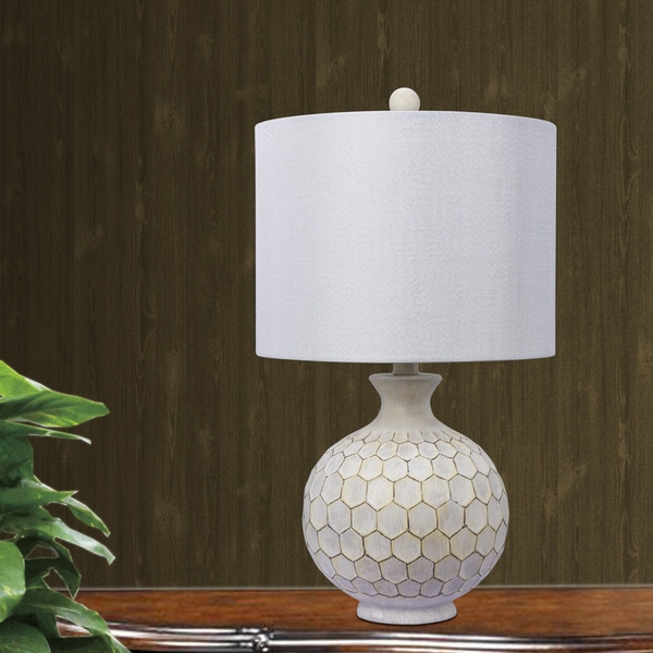 Fangio Lighting's 21.5 in. Resin Table Lamp in an Antique Ivory Finish