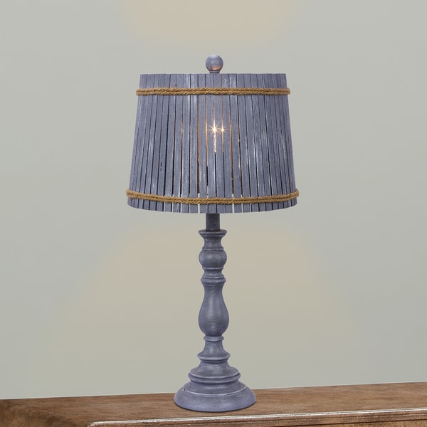 Fangio Lighting's 24.5 in. Resin Table Lamp in a Grey Finish