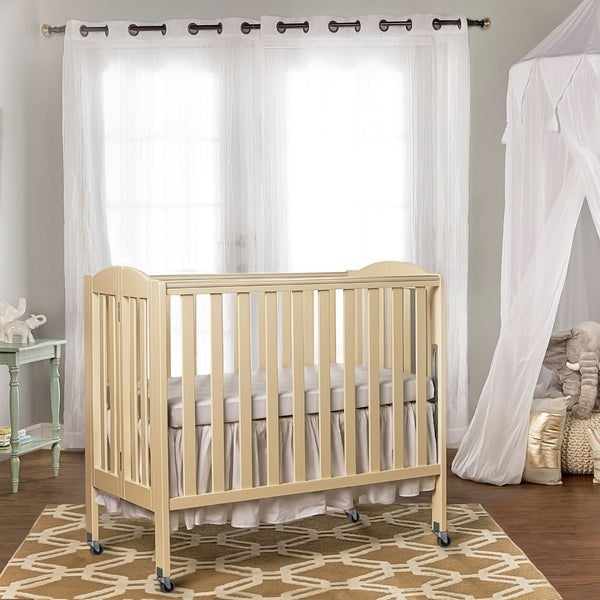 Dream On Me 3 in 1 Folding Portable Crib, French White. Opens flyout.