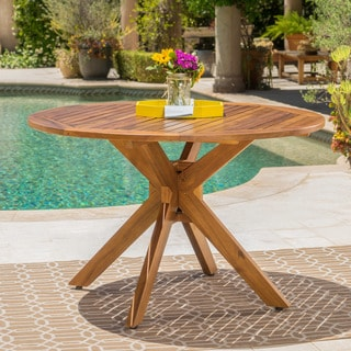 Link to Stamford Outdoor Acacia Wood Round Dining Table by Christopher Knight Home Similar Items in Outdoor Dining Sets