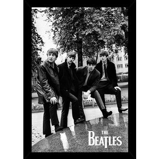 The Beatles Pose Poster in a Black Poster Frame (24x36)