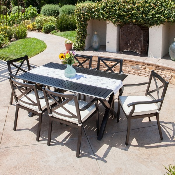 Exuma Outdoor Black Cast Aluminum Dining Set with Ivory Water Resistant Cushions by Christopher Knight Home. Opens flyout.