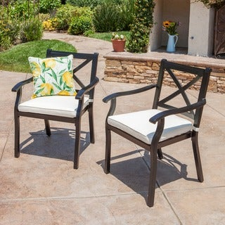 Link to Exuma Outdoor Black Cast Aluminum Dining Chairs with Ivory Water Resistant Cushions (Set of 2) by Christopher Knight Home Similar Items in Patio Dining Chairs