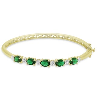 Dolce Giavonna Gold Overlay Simulated Emerald and Diamond Accent Bangle
