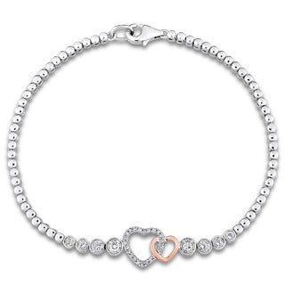 Miadora 2-Tone White and Rose Plated Sterling Silver White Topaz 1/10ct TDW Diamond Interlaced Heart Bracelet