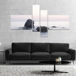 Designart 'Rocks in the Sea Black and White' Seashore Canvas Art Print