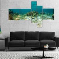 Designart 'School of Grunts with Baracuda' Seashore Canvas Art Print