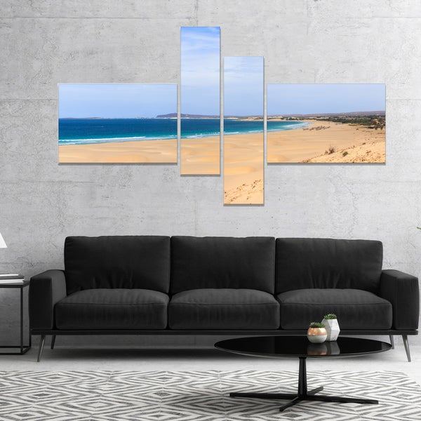 Designart 'Sea and Clouds in Blue Sky' Seashore Canvas Art Print
