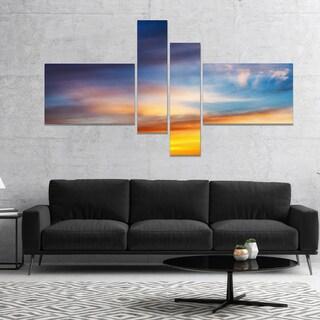 Designart 'Sunset Dramatic Yellow Sky Clouds' Seashore Canvas Art Print