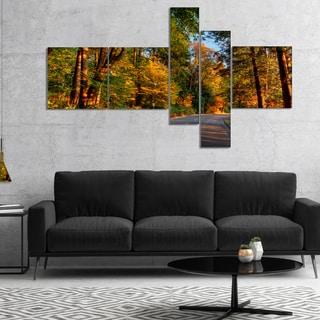 Designart 'Road through Lit up Fall Forest' Landscape Canvas Art