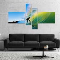 Designart 'Surfer Beating Green Waves' Photography Canvas Art Print
