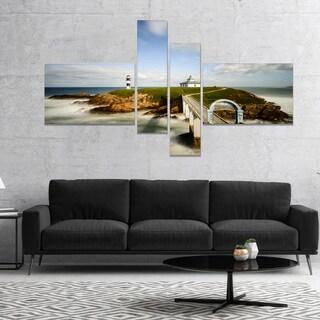 Designart 'Cloudy Illa Pancha Lighthouse' Seashore Photo Canvas Print