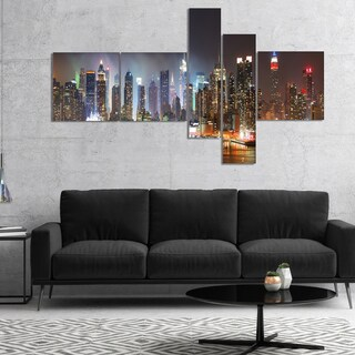 Designart 'Lit NYC Manhattan Skyline' Cityscape Photo Canvas Print - Brown
