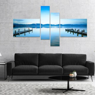 Designart 'Two Wooden Piers in Blue Sea' Seascape Canvas Art Print (2 options available)