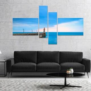 Designart 'Pier and Lightour in Sunset' Seascape Canvas Art Print (2 options available)