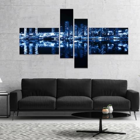 Designart 'Glowing City at Midnight' Cityscape Photo Canvas Print - Blue