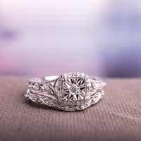 Miadora Sterling Silver 1/5ct TDW Diamond Halo Infinity Bridal Ring Set