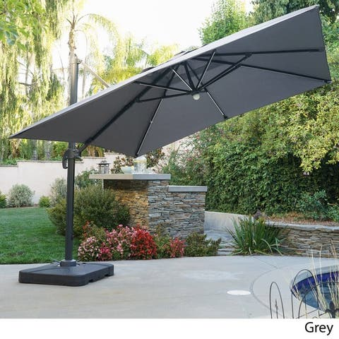 a7e696e6c5f4 Delray Outdoor 9.7 ft. Canopy Umbrella with Base and Solar Light Strip by  Christopher Knight