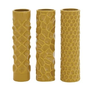 Studio 350 Ceramic Vase Set of 3, 3 inches wide, 12 inches high https://ak1.ostkcdn.com/images/products/17291091/P23541022.jpg?impolicy=medium