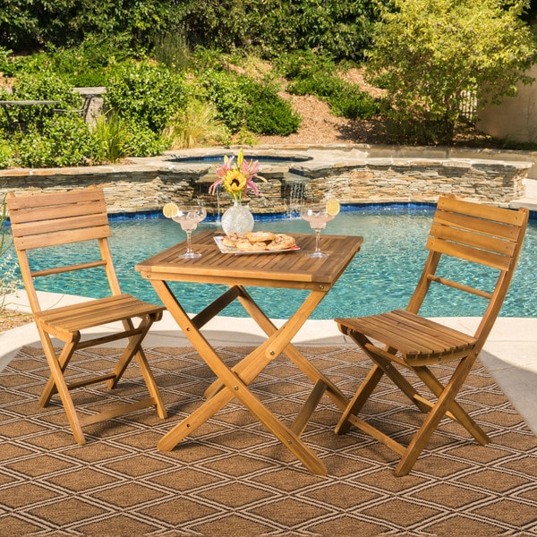 Positano Outdoor 3-piece Foldable Acacia Wood Bistro Set by Christopher Knight Home. Opens flyout.