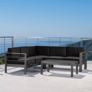 Cape Coral Outdoor Aluminum Tempered Glass 4-piece V-Shape Sectional Sofa Set with Cushions by Christopher Knight Home