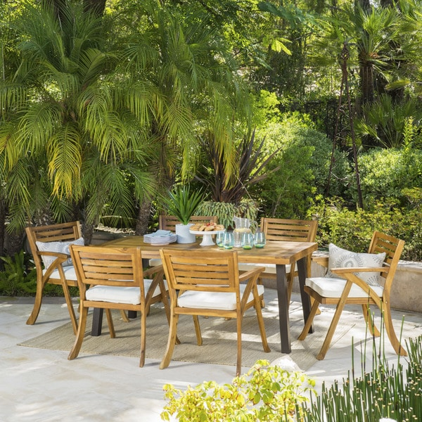 Della Outdoor 7-Piece Rectangle Acacia Wood Dining Set with Cushions by Christopher Knight Home. Opens flyout.