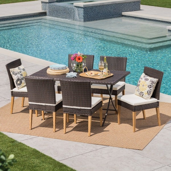 Jase Outdoor 7-Piece Rectangle Foldable Wicker Dining Set with Umbrella Hole & Cushion by Christopher Knight Home