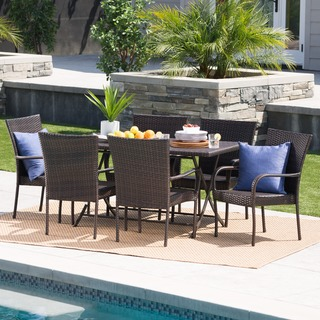 Link to Neva Outdoor 7-Piece Rectangle Foldable Wicker Dining Set with Umbrella Hole by Christopher Knight Home Similar Items in Patio Furniture