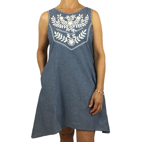 Handmade cotton dress with floral hand-embroidered details. Produced by traditional artisans in Oaxaca, Mexico. Fairly traded.