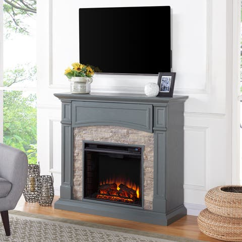 The Gray Barn Cavern Sprite Grey and Weathered Stone Electric Media Fireplace
