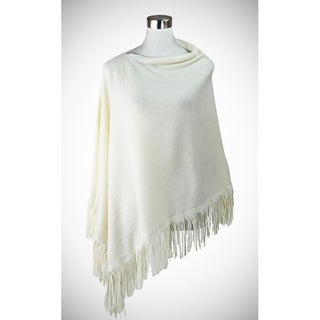 Solid asymmetric cut poncho with subtle faux suede fringe for accent.
